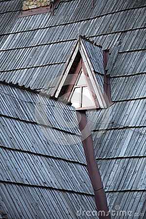Detail of protective wooden shingle on roof