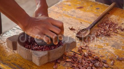 Detail Shot of Hands Grinding Cacaobonen with a Mortar stock video