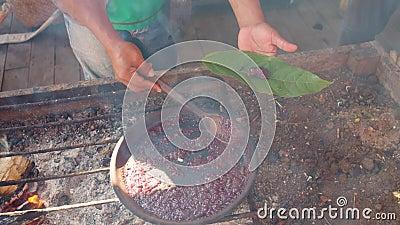 Detail Shot of Man Serving on a Leaf Cooked Organic Caca Paste stock videobeelden