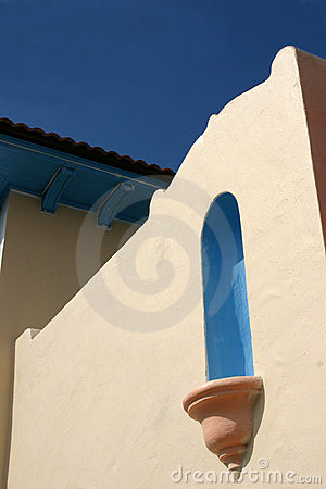 Detail of stucco wall against blue sky