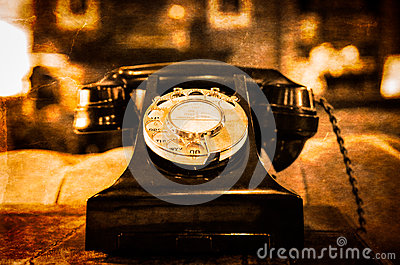 Detail view of old vintage dial telephone on the table