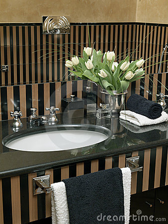 Detail of washbasin with black marble top