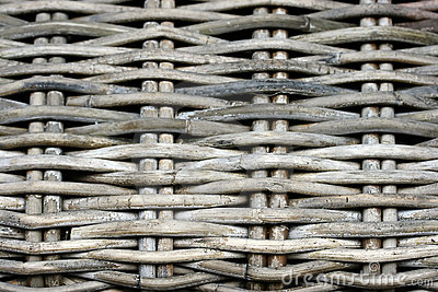 Detail of a weathered cane beach chair