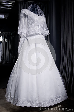 Detail of a weddings dress on a mannequin