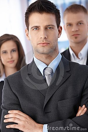 Determined businessman with coworkers