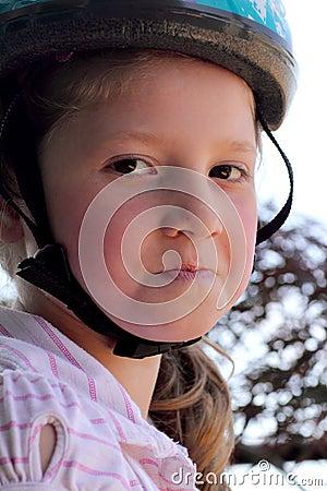 Determined girl wearing helmet