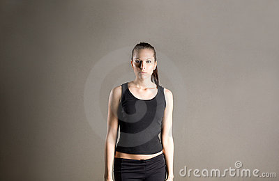Determined looking youn fitness girl.