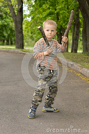 Free Determined Macho Little Boy Stick Fighting Royalty Free Stock Images - 40131879