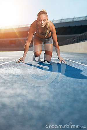 Free Determined Sprinter At Starting Block Stock Photography - 59716072