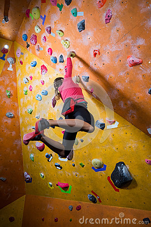 Free Determined Woman Practicing Rock Climbing Stock Photo - 97386720