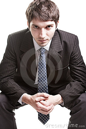 Determined young businessman over white