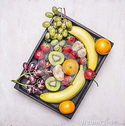 Free Detox And Diet Food Concept,  Fresh Fruit, Bananas, Grapes, Kiwi And Tangerine, Strawberry Lined Vintage Wooden Box Top View Royalty Free Stock Photos - 73554658