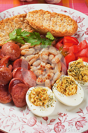 Deviled eggs with beans and sausage