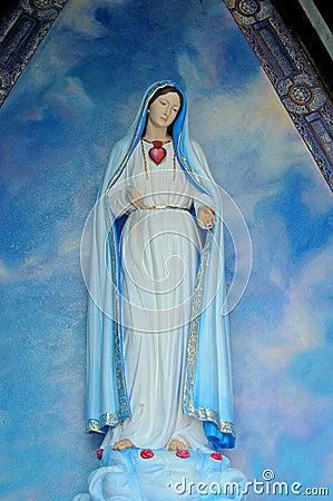 Devote Mary in little chapel