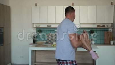 Devoted father spinning daughter in circle at home stock footage
