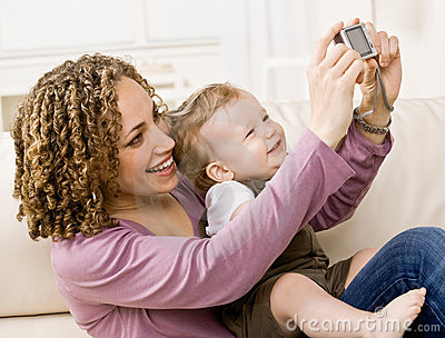 Devoted mother taking self-portrait happy son