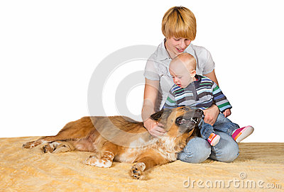 Devoted Mum, baby and family dog