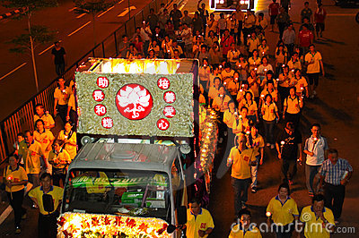 Devotees following the floats at Wesak Procession Editorial Photo
