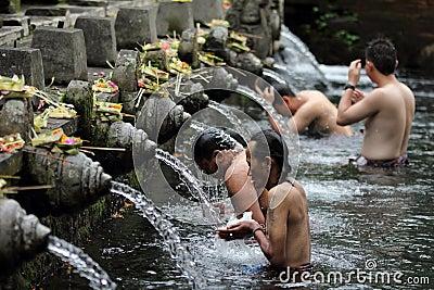 Men Ritual Bathing at Puru Tirtha Empul, Bali Editorial Photo
