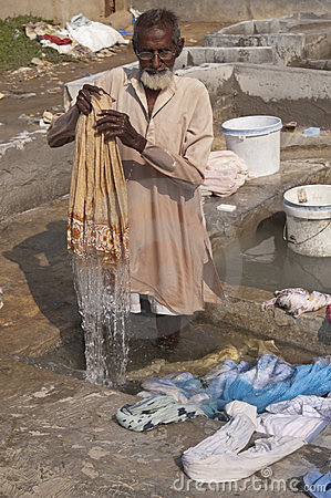 Dhobi Wallah at work Editorial Image