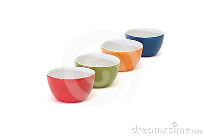 Diagonal row of four porcelain bowls isolated