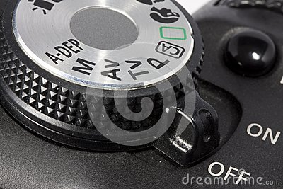 Dial and on/off button on DSLR camera