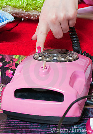 Dialing number on pink phone