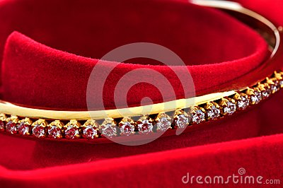 Diamond on the golden bracelet