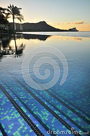 Diamond Head is reflected in an infinity pool