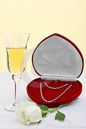 Diamond necklace with champagne and white rose.