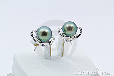 Diamond and Pearl Earring over white background