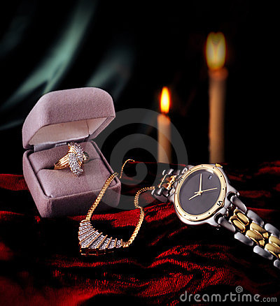 Diamond ring, gold watch, and necklace