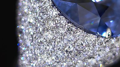 Diamond ring, not 3D, it`s video shooting only. Extreme close up. Big blue gemstone. Natural diamonds dispersion. Extreme close up. Tilt shift lens bokeh stock video footage