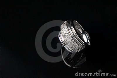 Diamond ring with reflection in isolated black bac