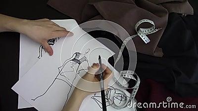 Dibujo del diseñador de moda almacen de video