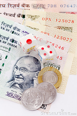 Dice and Indian currency