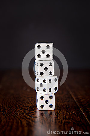 Dice on Wood Table Background
