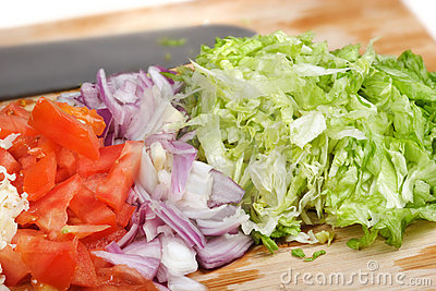 Diced vegetables and cheese on cutting board