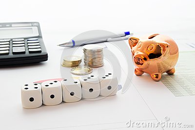 Dices, coins stack on business background