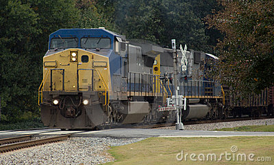 Diesel locomotive with safety crossing arms