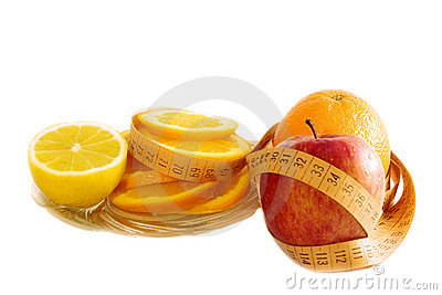 Diet concept - fruits and measure tape on white