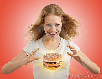 Diet concept. Happy girl, magic  hamburger