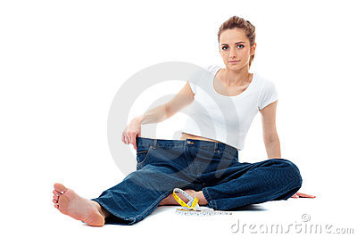 Diet concept, woman shows her old huge jeans