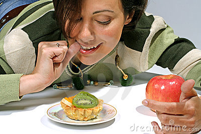 Diet  temptation - cake against apple
