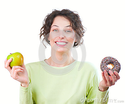 Diet. Woman choosing between Fruit and Donut