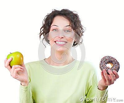 Diet. Woman choosing between Fruit and Donut