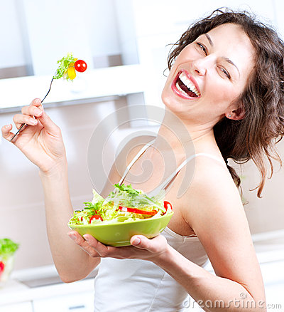 Free Diet. Woman Eating Vegetable Salad Royalty Free Stock Photo - 26750865