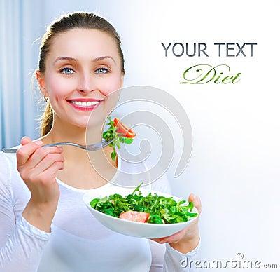 Diet. Woman Eating Vegetables