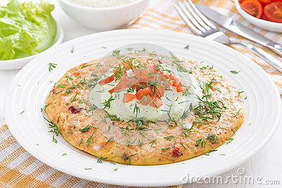 dietary omelette with carrot and green yogurt sauce on a plate