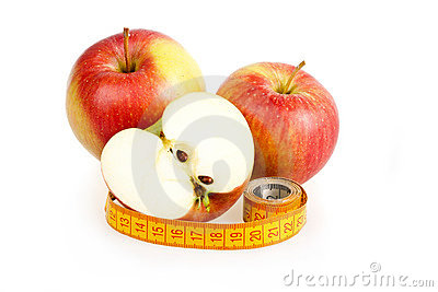 Dieting concept with apple and measuring tape
